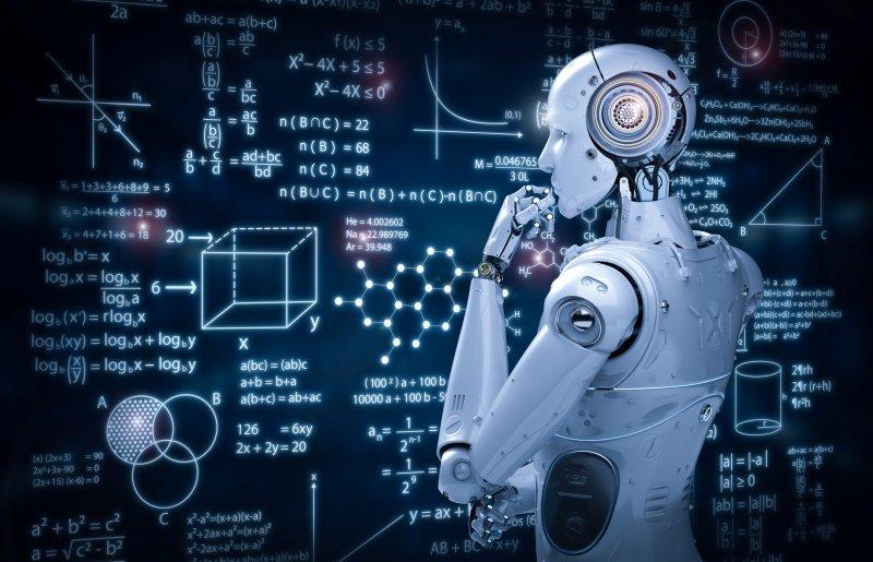 A white robot looks at a complex computer algorithm