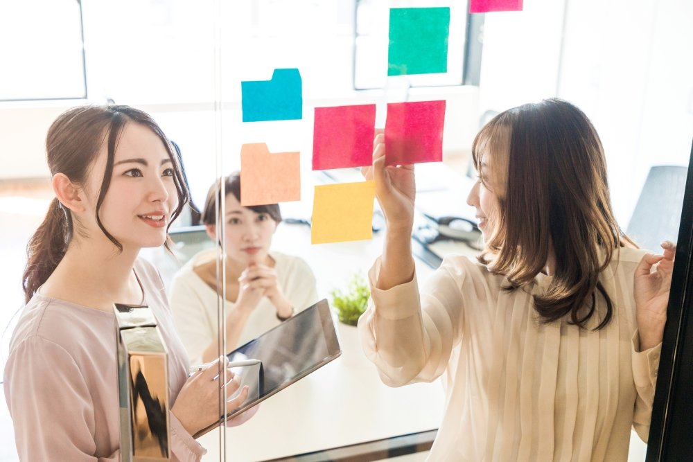A group of female Japanese office workers plan their advertising
