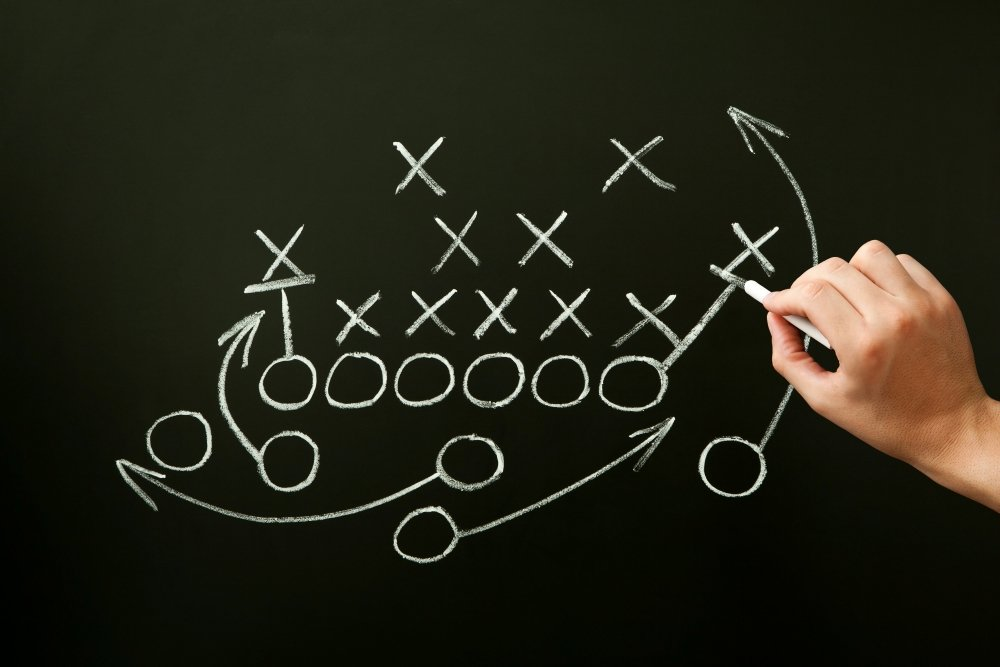 Coach Drawing American Football Playbook Tactics stock photo